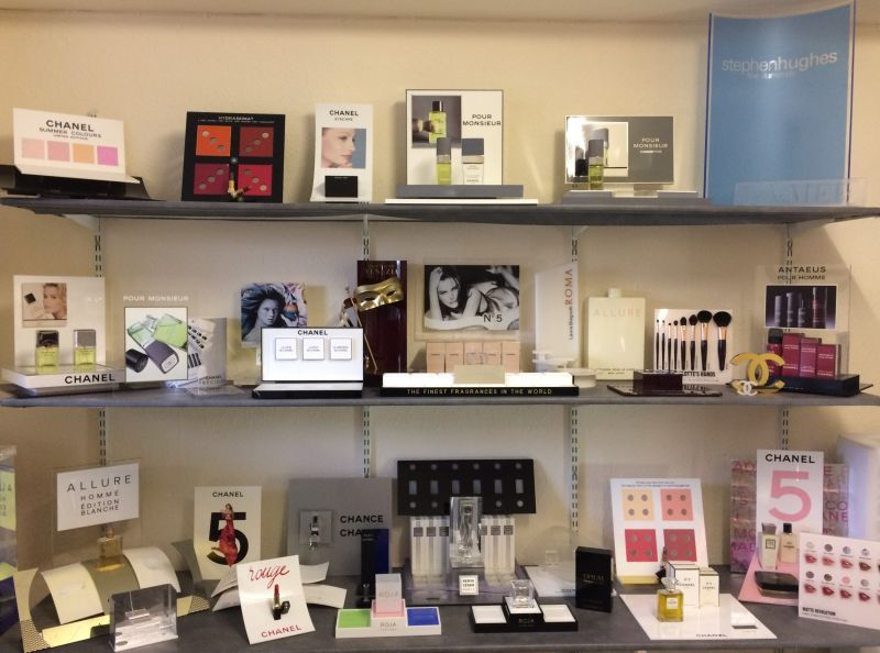 Fragrance & cosmetic display in the Carlon showroom : Swipe To View More Images